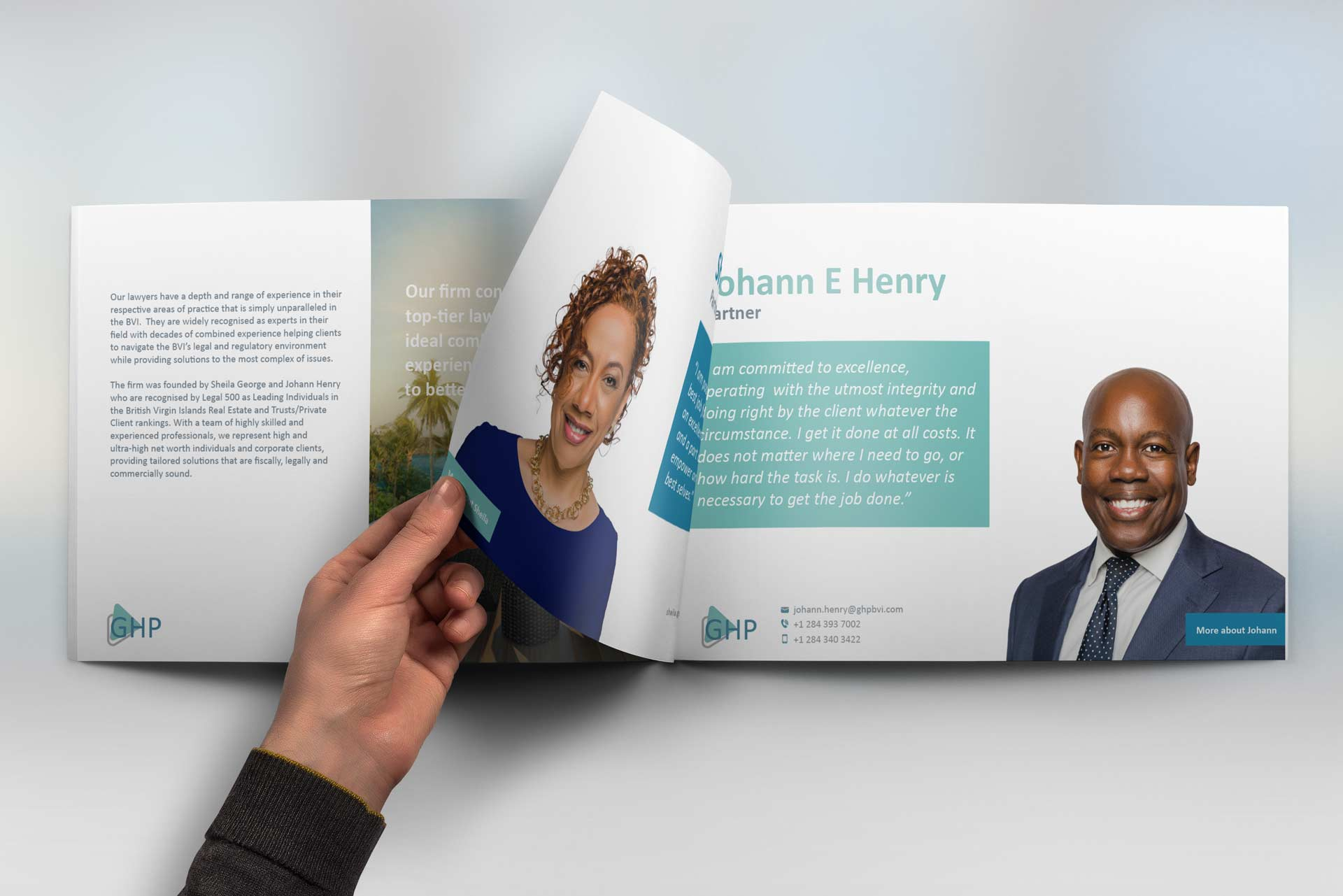 A Hand turning a page of a printed and bound corporate brochure